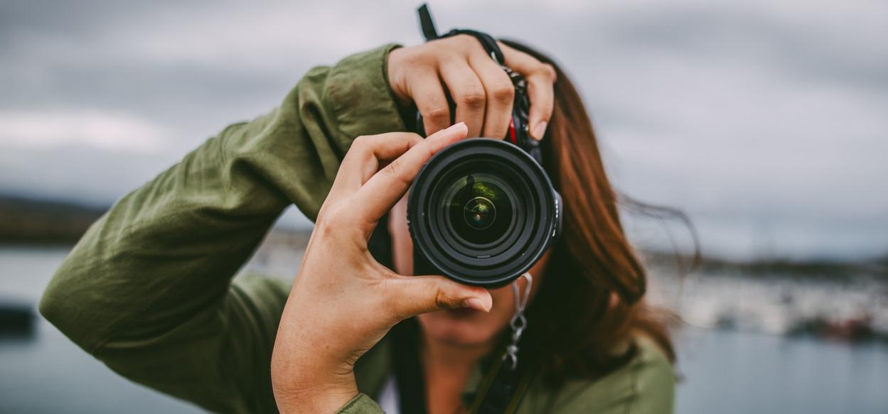 female photographer using a DSLR camera