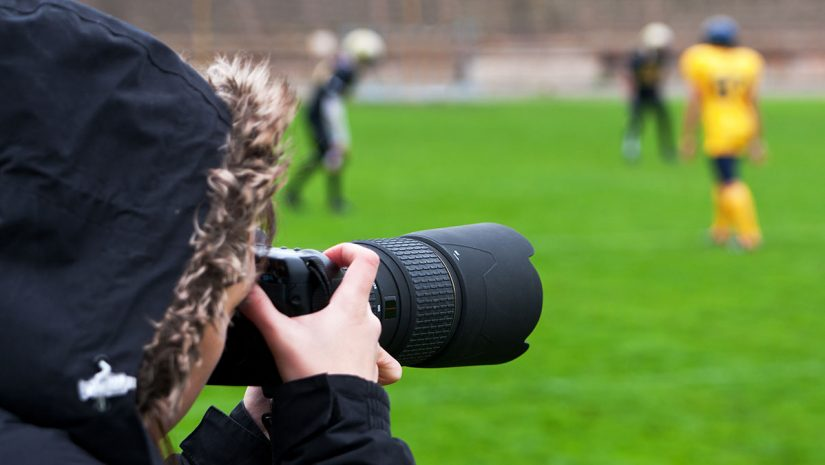Instagram Photographer taking pictures of a football player