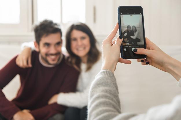 taking photos of a couple