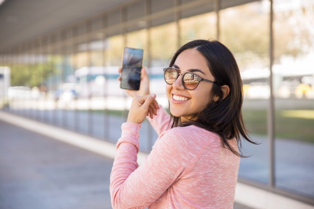 young lady taking selfie photos